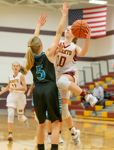 Richmond-Burton's Kasey Miller goes up for the shot against Woodstock North's Kaitlyn Ford Thursday, January 17, 2019 in Richmond. Miller finished with 17 points including four 3-pointers as Richmond took the conference win 53-41. KKoontz – For Shaw Media