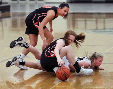 Candace H. Johnson-For Shaw Media Libertyville's Maddie Spaulding and Lydia Crow scramble for a loose ball with Grayslake North's Eden Hartigan in the second quarter at Grayslake North High School. Libertyville won 62-41. (1/12/19)