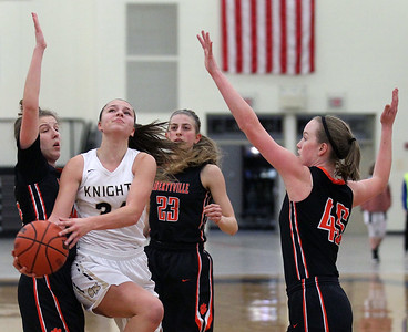 Candace H. Johnson-For Shaw Media Grayslake North's Savannah Guenther finds an opening against Libertyville's Lauren Huber, Marianna Morrissey and Abigail Frea in the third quarter at Grayslake North High School. Libertyville won 62-41. (1/12/19)