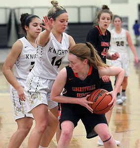Candace H. Johnson-For Shaw Media Libertyville's Lydia Crow (on right) brings down a rebound against Grayslake North's Jayden Curtis and Faith Standerski in the third quarter at Grayslake North High School. Libertyville won 62-41. (1/12/19)
