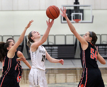 Candace H. Johnson-For Shaw Media Grayslake North's Meghan Leahy (center) tries to maneuver as Libertyville's Elise Rodriquez and Abby Parkerson defend in the second quarter at Grayslake North High School. Libertyville won 62-41. (1/12/19)