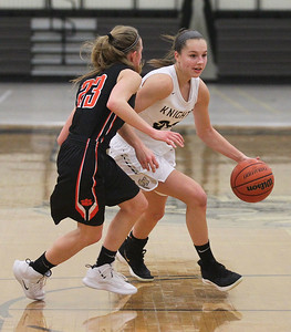 Candace H. Johnson-For Shaw Media Grayslake North's Savannah Guenther drives on Libertyville's Marianna Morrissey (#23) in the first quarter at Grayslake North High School. Libertyville won 62-41. (1/12/19)