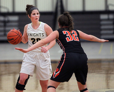 Candace H. Johnson-For Shaw Media Grayslake North's Margaret Stanfel looks to get around Libertyville's Margaret Buchert in the third quarter at Grayslake North High School. Libertyville won 62-41. (1/12/19)