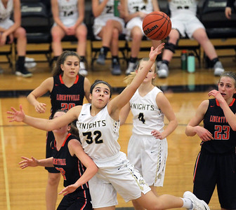 Candace H. Johnson-For Shaw Media Grayslake North's Jayden Curtis (#32) looks to grab a rebound over Libertyville's Brooke Bair in the fourth quarter at Grayslake North High School. Libertyville won 62-41. (1/12/19)