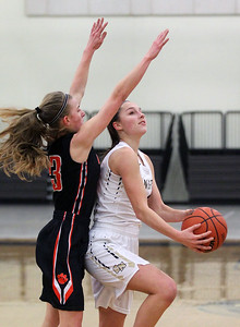 Candace H. Johnson-For Shaw Media Grayslake North's Savannah Guenther (on right) looks up for a shot against Libertyville's Marianna Morrissey in the second quarter at Grayslake North High School. Libertyville won 62-41. (1/12/19)