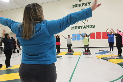 Candace H. Johnson-For Shaw Media Heidi Droessler, of Grayslake, instructor, leads her Yoga Class, sponsored by Mano a Mano, at the W.J. Murphy Elementary School in Round Lake Park. (1/11/19)