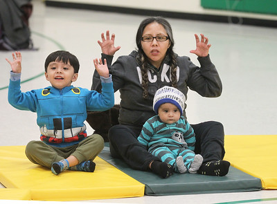 Candace H. Johnson-For Shaw Media Jumberto Bustamante, 4, of Round Lake, his sister, Kimberly, 1, and mother, Margarita Franco Mendez, learn a fun way on how to breathe during a Yoga Class sponsored by Mano a Mano at the W.J. Murphy Elementary School in Round Lake Park. (1/11/19)