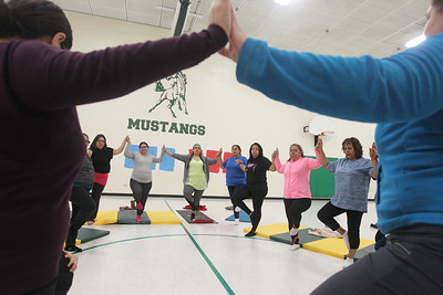 Candace H. Johnson-For Shaw Media Everyone comes together during the Yoga Class led by instructor Heidi Droessler, of Graylake (on right) and sponsored by Mano a Mano at the W.J. Murphy Elementary School in Round Lake Park. Families were welcomed.(1/11/19)