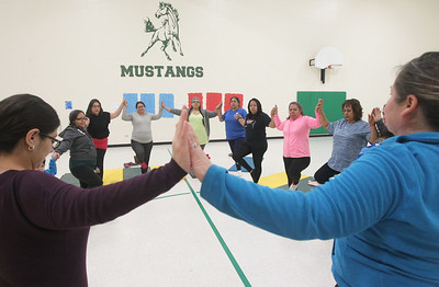 Candace H. Johnson-For Shaw Media Everyone comes together during a Yoga Class led by instructor Heidi Droessler, of Graylake (on right) and sponsored by Mano a Mano at the W.J. Murphy Elementary School in Round Lake Park. Families were encouraged to participate.(1/11/19)