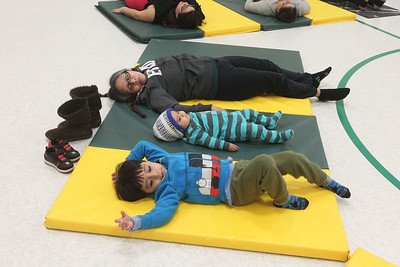 Candace H. Johnson-For Shaw Media Jumberto Bustamante, 4, of Round Lake, his sister, Kimberly, 1, and mother, Margarita Franco-Mendez, take a Yoga Class sponsored by Mano a Mano at the W.J. Murphy Elementary School in Round Lake Park. (1/11/19)