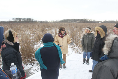 Candace H. Johnson-For Shaw Media Amy Polster, of Lindenhurst, a volunteer, leads a tour on a floating walkway through the Volo Bog during WinterFest at the Volo Bog State Natural Area on Brandenburg Road in Ingleside. (1/13/19)