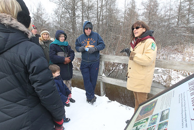 Candace H. Johnson-For Shaw Media Amy Polster, of Lindenhurst, a volunteer, leads a tour through the Volo Bog and stops at the Eye of the Volo Bog during WinterFest at the Volo Bog State Natural Area on Brandenburg Road in Ingleside. (1/13/19)