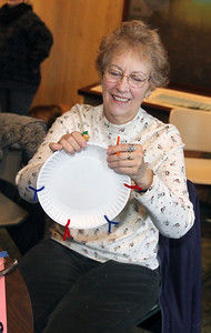 Candace H. Johnson-For Shaw Media Susan Hahl, of Ingleside makes a drum craft in the Visitor Center during WinterFest at the Volo Bog State Natural Area on Brandenburg Road in Ingleside. (1/13/19)
