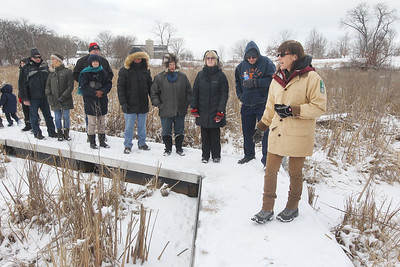 Candace H. Johnson-For Shaw Media Amy Polster, of Lindenhurst, (on right) a volunteer, leads a tour on a floating walkway through the Volo Bog during WinterFest at the Volo Bog State Natural Area on Brandenburg Road in Ingleside. (1/13/19)