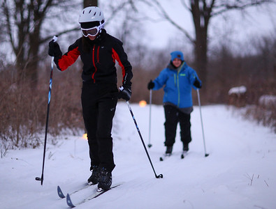 Cross country skiers brave winter weather for candlelight ski
