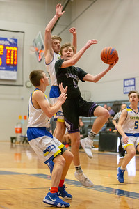 Hampshire's Jackson Milison drives to the basket against Johnsburg Monday, January 21, 2019 at the Martin Luther King Tournament held at Burlington Central High School in Hampshire. Hampshire gets the win in overtime 68-66. KKoontz – For Shaw Media