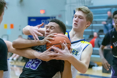 Hampshire's Jeremy Rosa Jr and Johnsburg's Kyle Muehlfelder battle for possession of the ball Monday, January 21, 2019 at the Martin Luther King Tournament held at Burlington Central High School in Hampshire. Hampshire gets the win in overtime 68-66. KKoontz – For Shaw Media