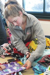 Candace H. Johnson-For Shaw Media Volunteer Lilia Begin, 17, of Grayslake works on making blankets for shelter pets at Save-A-Pet during Kindness Crafts-MLK Day ON, Not a Day Off at the Grayslake Area Public Library. (1/21/19)