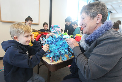 Candace H. Johnson-For Shaw Media Mason Whitmore, 6, and his grandmother, Mary Robinson, both of Grayslake show the blanket they made together for a shelter pet at Save-A-Pet during Kindness Crafts-MLK Day ON, Not a Day Off at the Grayslake Area Public Library. (1/21/19)