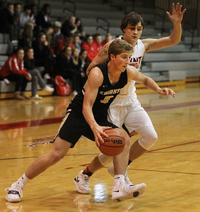 Candace H. Johnson-For Shaw Media Grayslake North's Austin Martineau drives to the basket against Grant's Hunter Waszkowski during the second half at Grant Community High School in Fox Lake. Grant won 61-51. (1/26/19)