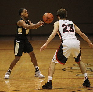 Candace H. Johnson-For Shaw Media Grayslake North's Jamon Thomas passes the ball against Grant's Henry Kusiak during the second half at Grant Community High School in Fox Lake. Grant won 61-51. (1/26/19)