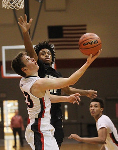 Candace H. Johnson-For Shaw Media Grant's Henry Kusiak looks up for a shot against Grayslake North's Tony Hines during the second half at Grant Community High School in Fox Lake. Grant won 61-51. (1/26/19)