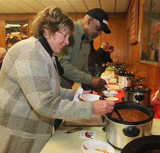 Candace H. Johnson-For Shaw Media Judy Martini, of Fox Lake with Lake County Board District #5, and John Idleburg, Lake County sheriff, help themselves to some chili during the Fox Lake-Round Lake Rotary Club's 13th Annual Chili Cook-Off at the American Legion Post 703 in Fox Lake. Martini was a judge at the event and sampled twenty chili entries. Chili entrees came from local school districts, fire departments and businesses.(1/26/19)