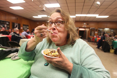 Candace H. Johnson-For Shaw Media Jackie Black, of Ingleside, secretary of the Rotary, enjoys her chili on top of macaroni and cheese during the Fox Lake-Round Lake Rotary Club's 13th Annual Chili Cook-Off at the American Legion Post 703 in Fox Lake. (1/26/19)