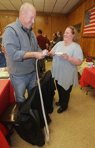 Candace H. Johnson-For Shaw Media Jeff Sefcik, of Wauconda, principal of Stanton Middle School, works on separating his 50/50 raffle tickets as he talks with Jane Ferrigan-Wilson, of Spring Grove during the Fox Lake-Round Lake Rotary Club's 13th Annual Chili Cook-Off at the American Legion Post 703 in Fox Lake. Both submitted chili entries for consideration in the cook-off.(1/26/19)
