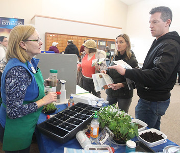 Candace H. Johnson-For Shaw Media Kim Isaacson, of Ingleside, program coordinator with the University of Illinois Extension, talks with Lisa Giametta and Ian Blackburn, both of Hainesville about starting seedlings during the 3rd Annual Round Lake Area Garden Club Seed Expo at the Round Lake Beach Cultural & Civic Center. (1/26/19)