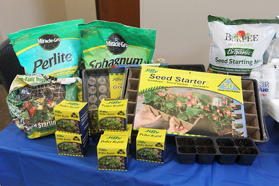 Candace H. Johnson-For Shaw Media The University of Illinois Extension master gardeners gardening display showed products to help with  growing their seeds given out during the 3rd Annual Round Lake Area Garden Club Seed Expo at the Round Lake Beach Cultural & Civic Center. (1/26/19)