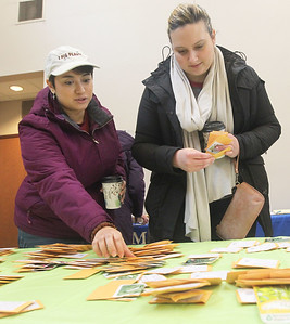 Candace H. Johnson-For Shaw Media Ashley Wold, of Waukegan and Brandi Ferree, of Kenosha, Wis., look for packets of different vegetable seeds during the 3rd Annual Round Lake Area Garden Club Seed Expo at the Round Lake Beach Cultural & Civic Center. (1/26/19)