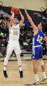 Candace H. Johnson-For Shaw Media Grayslake North's Jason Donohue leaps up for a shot against Lake Forest's Leo Scheidler in the first quarter at Grayslake North High School. Lake Forest won 56-43. (1/7/19)