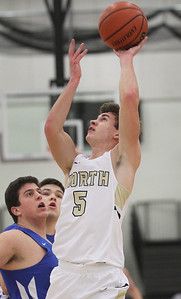 Candace H. Johnson-For Shaw Media Grayslake North's Joe Swanson puts up a shot over Lake Forest's Stephen Young and Cade Nowik in the second quarter at Grayslake North High School. Lake Forest won 56-43. (1/7/19)