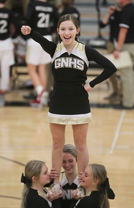 Candace H. Johnson-For Shaw Media Grayslake North's Zaidie Schmidt, 14, of Round Lake performs a routine with the cheerleaders before the start of the fourth quarter during the boys varsity basketball game against Lake Forest at Grayslake North High School.  (1/7/19)