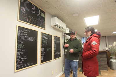 Candace H. Johnson-For Shaw Media Zac Camp, owner, talks to Ivy Poprawski, of Round Lake about the different CBD American Shaman products he sells at CBD Grayslake on Center Street in Grayslake. (1/4/20)