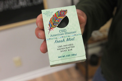Candace H. Johnson-For Shaw Media Zac Camp, owner, holds a bar of CBD American Shaman Fresh Mint CBD Infused soap he sells at CBD Grayslake on Center Street in Grayslake. (1/4/20)