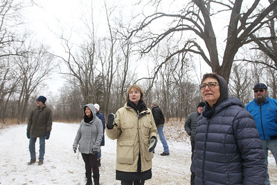 Candace H. Johnson-For Shaw Media Nancy Vanden Berge, of Long Grove, (center) volunteer naturalist, stops to talk about different habitats during Walk with a Naturalist at Grant Woods on West Monaville Rd. in Ingleside. (1/4/20) The next Walk with a Naturalist will be at the Greenbelt Forest Preserve in North Chicago on Saturday, February 1st, from 9-10:30 am. Everyone will meet at the Greenbelt Cultural Center. The walks are hosted by the Lake County Forest Preserves.