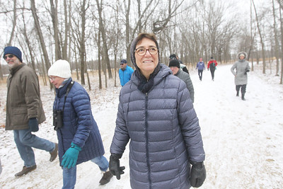 Candace H. Johnson-For Shaw Media Sue Versino, of Deerfield looks up at the trees as she walks through Grant Woods during Walk with a Naturalist at Grant Woods on West Monaville Rd. in Ingleside. (1/4/20) The next Walk with a Naturalist will be at the Greenbelt Forest Preserve in North Chicago on Saturday, February 1st, from 9-10:30 am. Everyone will meet at the Greenbelt Cultural Center. The walks are hosted by the Lake County Forest Preserves.