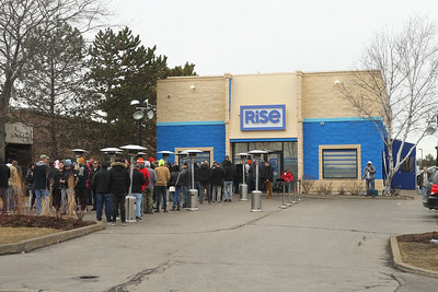 Candace H. Johnson-For Shaw Media A long line of people wait to get into Rise Mundelein for cannabis products on Armour Blvd. in Mundelein.  (1/7/19)