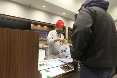 Candace H. Johnson-For Shaw Media Desten Ramirez, of Gurnee, a patient care specialist, helps a customer as they buy cannabis products at Rise Mundelein on Armour Blvd. in Mundelein.  (1/7/19)