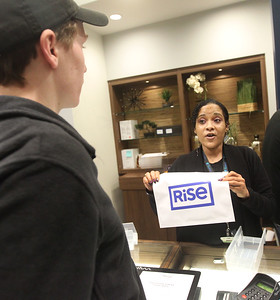 Candace H. Johnson-For Shaw Media Shannon Eady, of North Chicago, a patient care specialist, helps Brian A., as he buys cannabis products at Rise Mundelein on Armour Blvd. in Mundelein.  (1/7/19)