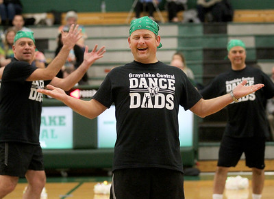 Candace H. Johnson-For Shaw Media Mark Groenke, of Grayslake honors his daughter, Sophia, by performing a routine with other Grayslake Central Dance Dads whose daughters are seniors on the Dance Team at half-time during the varsity girls basketball game against Antioch at Grayslake Central High School. (1/13/20)