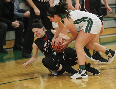 Candace H. Johnson-For Shaw Media Antioch's Erin Miller battles for control with Grayslake Central's Madeline Mussay in the first quarter at Grayslake Central High School. Grayslake Central won 60-26. (1/13/20)