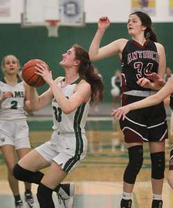 Candace H. Johnson-For Shaw Media Grayslake Central's Kate Bullman goes up for a shot against Antioch's Avery Larson in the first quarter at Grayslake Central High School. Grayslake Central won 60-26. (1/13/20)