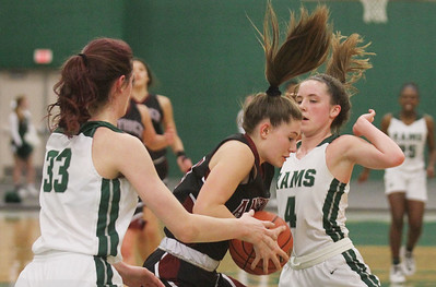 Candace H. Johnson-For Shaw Media Antioch's Gianna Riforgiato pulls down a rebound against Grayslake Central's Kate Bullman and Mary Katherine Drevline in the second quarter at Grayslake Central High School. Grayslake Central won 60-26. (1/13/20)