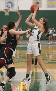 Candace H. Johnson-For Shaw Media Antioch's Avery Larson tries to block a shot by Grayslake Central's Amanda Kocialkowski in the second quarter at Grayslake Central High School. Grayslake Central won 60-26. (1/13/20)