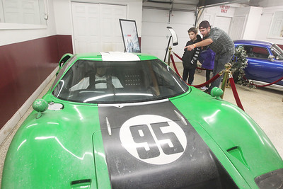 "Candace H. Johnson-For Shaw Media Danny Olsen, of Barrington shows his son, Danny, 8, a Ford GT40 racing car at the ""Ford v Ferrari"" GT40 Special Exhibit at the Volo Auto Museum. The Holman and Moody green and white No. 95 car was one of twelve GT40 replicas built for the movie, ""Ford v Ferrari."" The museum, which has several TV and movie cars on display, is open seven days a week 10:00 am-5:00 pm. (1/5/20)"