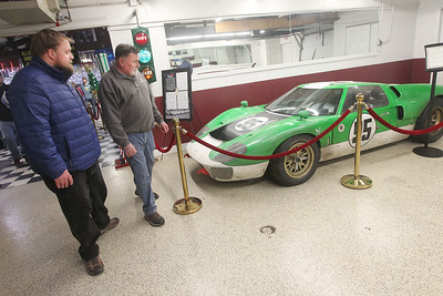 "Candace H. Johnson-For Shaw Media Jonathan Zieba and his father, Chet, both of Marengo look at a Ford GT40 racing car in the ""Ford v Ferrari"" GT40 Special Exhibit at the Volo Auto Museum. The Holman and Moody green and white No. 95 car was one of twelve GT40 replicas built for the movie, ""Ford v Ferrari.""  The museum has several TV and movie cars on display and is open seven days a week from 10:00 am -5:00 pm.(1/5/20)"