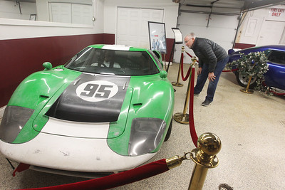 "Candace H. Johnson-For Shaw Media Dave Rhodes, of Cary looks at a Ford GT40 racing car in the ""Ford v Ferrari"" GT40 Special Exhibit at the Volo Auto Museum. The Holman and Moody green and white No. 95 car was one of twelve GT40 replicas built for the movie, ""Ford v Ferrari."" The museum, which has several TV and movie cars on display, is open seven days a week 10:00 am-5:00 pm. (1/5/20)"